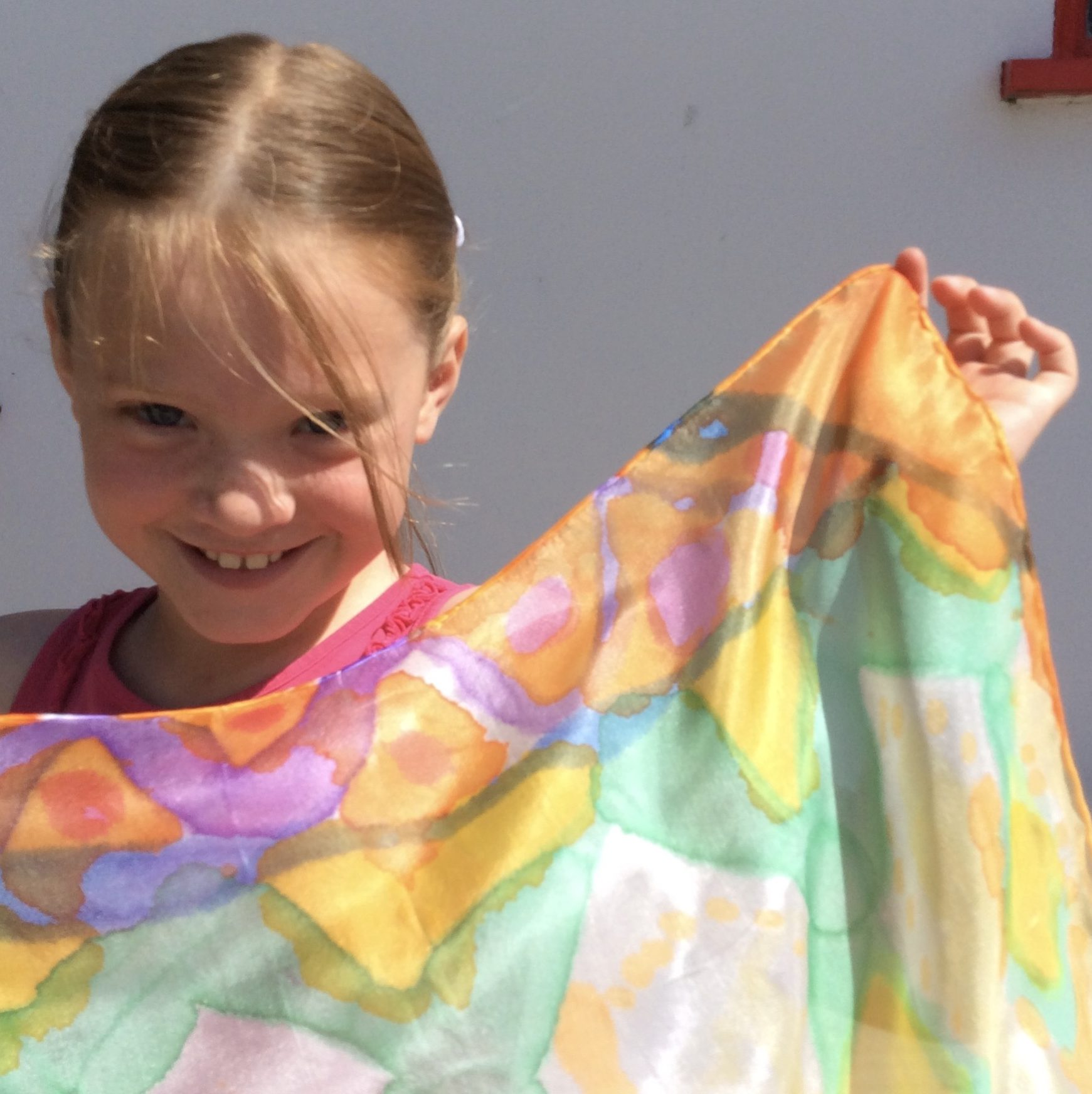 Young girl with her painted silk scarf